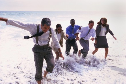 Businesspeople Playing in the Ocean